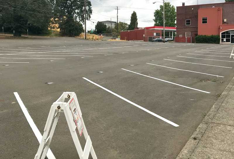 TIDINGS PHOTO: PATRICK MALEE - The 50 parking spots will be metered through an app called PassportParking, at a rate of $1 per hour.
