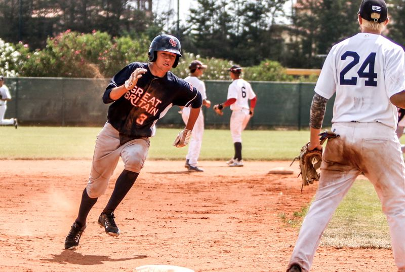 PHOTO COURTESY OF KREISBERG FAMILY - Lance Kreisberg (left), a Tigard senior-to-be and a member of the Great Britain team, rounds the bases during play at the European Championships.
