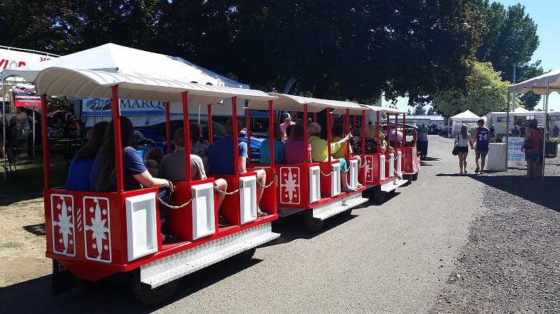HERALD PHOTO: JOHN BAKER - The trolley riders get a seated view of the Clackamas County Fair.