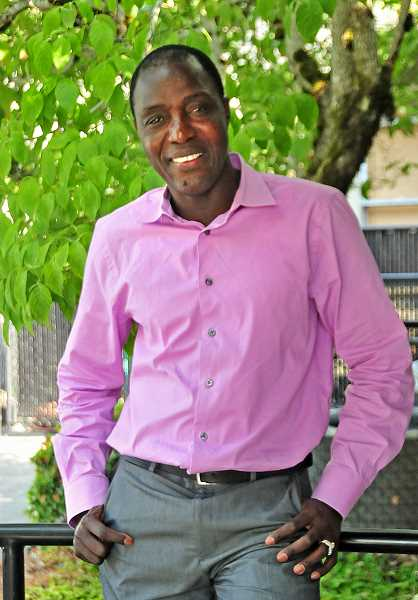 REVIEW PHOTO: VERN UYETAKE - Massene Mboup says he's pursuing a City Council seat in order to provide a voice for children, students and schools, and to highlight Lake Oswegos successes.