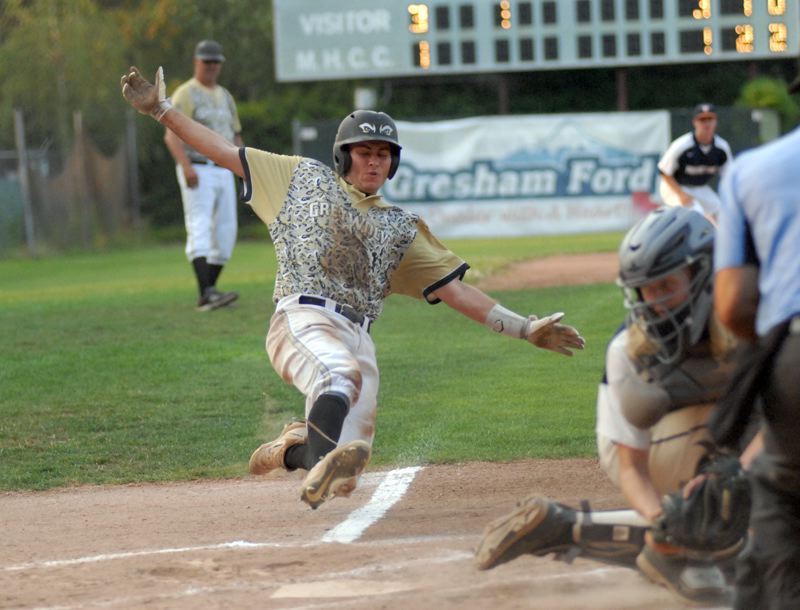 OUTLOOK PHOTO: MATT RAWLINGS - Todd Jackson slides safely into home in the first inning of the GreyWolves 7-6 win over Mound Time on Wednesday night.