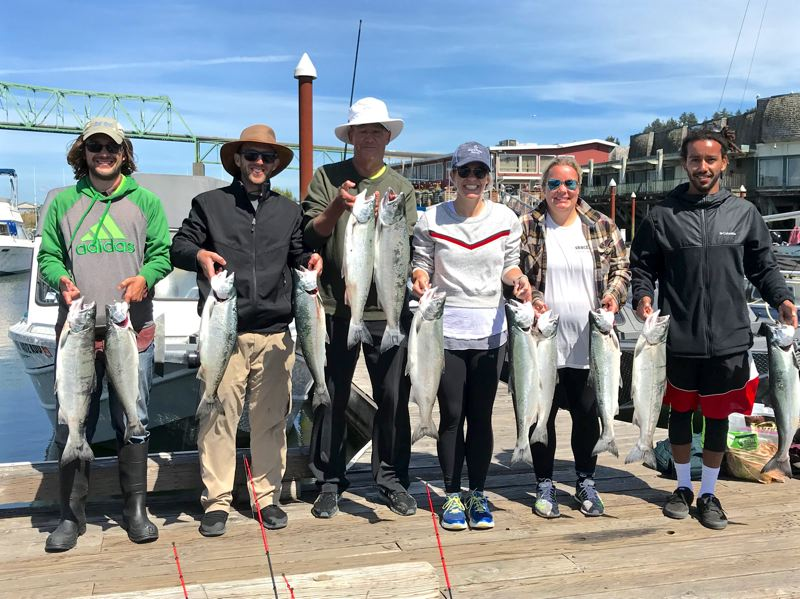 Jason Schray (far left) treated his family to an ocean outing in pursuit of coho. The group limited out by early afternoon on Sunday, August 5, using anchovies for bait.