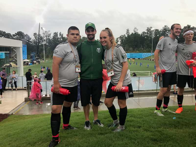 SUBMITTED PHOTO  - Jose Flores Chavez, Charlie Newton, unified soccer coach at Rainier High School, and Kendall Taylor were delegates for the 2018 MLS All-Star Game and played in the all-star unified soccer game.