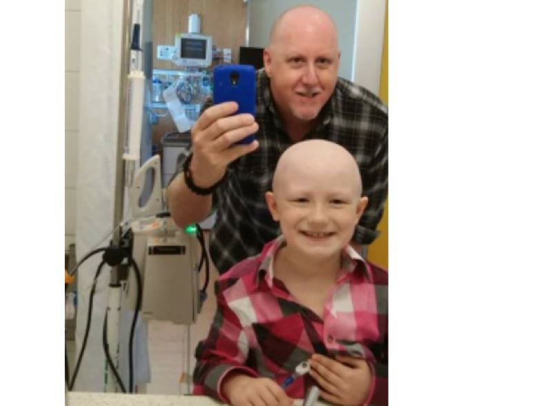 SUBMITTED PHOTO - Mark Whitton encourages his daughter, Sarah, to recover from cancer at Randall Children's Hospital after she was diagnosed with Ewing's sarcoma in October 2014.