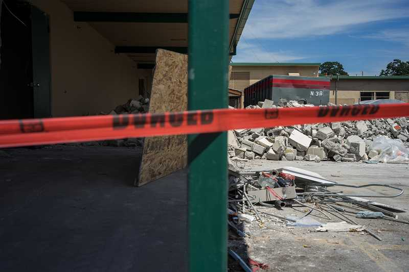 TIMES PHOTO: KIT MACAVOY - Last month, crews worked hard to take down Tigard High's commons area and the front parking lots. In the fall, students will have to eat and socialize in the cafeteria.