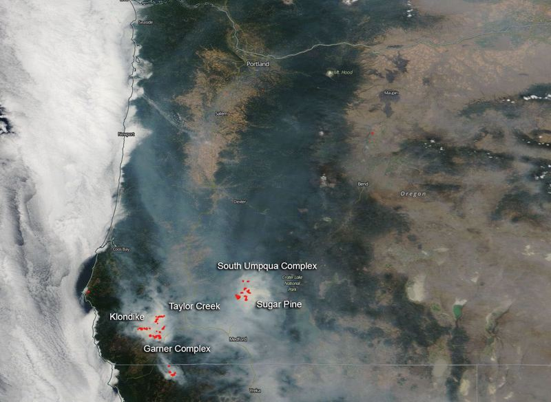 COURTESY PHOTO: NASA - A NASA photo taken Wednesday, Aug. 8, shows Southern Oregon wildfires from space. Smoke from the fires is drifting into the Portland area and could become unhealthy for some by late Thursday.