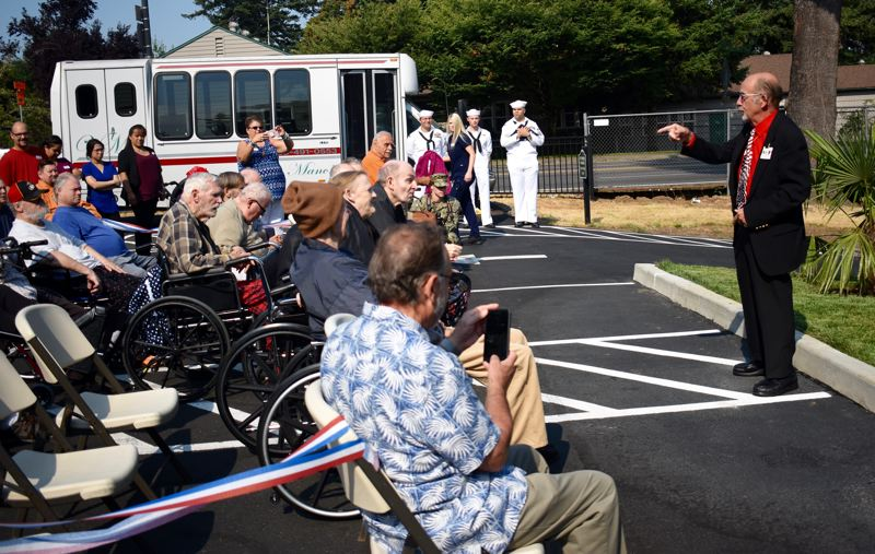 OUTLOOK PHOTO: MATT DEBOW - Chuck Dangerfield, exalted ruler of the Gresham Elks Lodge, says a few words before the flag rededication ceremony on Monday, Aug. 6.