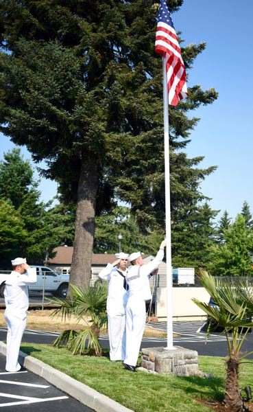 OUTLOOK PHOTO: MATT DEBOW - Navy Reserve members Justin Harlon, Christopher Seul and Alex Salinas raise the flag for the first time at Village Manor on Monday, Aug. 6.