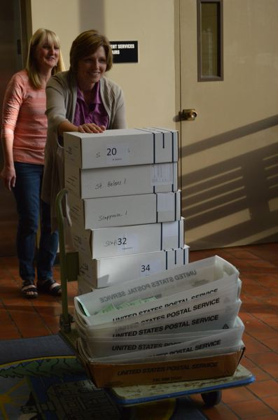 SPOTLIGHT FILE PHOTO - Election night workers haul boxes of ballots through the Columbia County Courthouse during a 2016 election. This November, several positions on local governing bodies are up for election.
