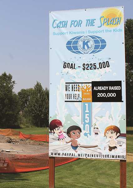 HOLLY SCHOLZ/CENTRAL OREGONIAN  - The Cash for the Splash sign, located at the future site of the splash park, shows that Kiwanis has raised $200,000 of the $225,000 goal.