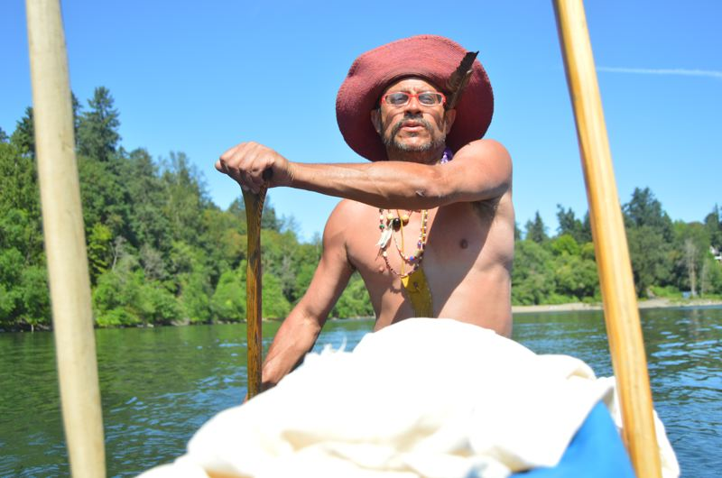 SPOTLIGHT PHOTO: NICOLE THILL-PACHECO - Willow Bill Goulardt steers the Flying Eagle down the Willamette River on a late June afternoon. The canoe was created in St. Helens in 2006 and is used by Willow each summer to take people on daytrips.