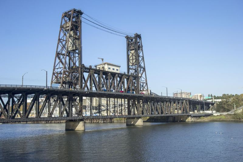 ALAN SYLVESTRE/OPB - The Steel Bridge carries TriMet MAX trains, and buses across the Willamette River.