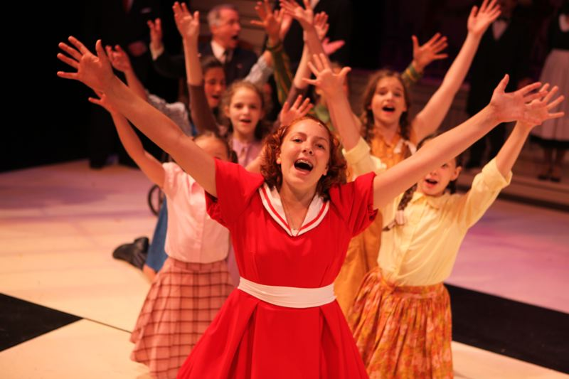CONTRIBUTED PHOTO: CLACKAMAS REPERTORY THEATER - Ava Marie Horton as Annie leads the Clackamas Repertory Theater in the song A New Deal for Christmas.