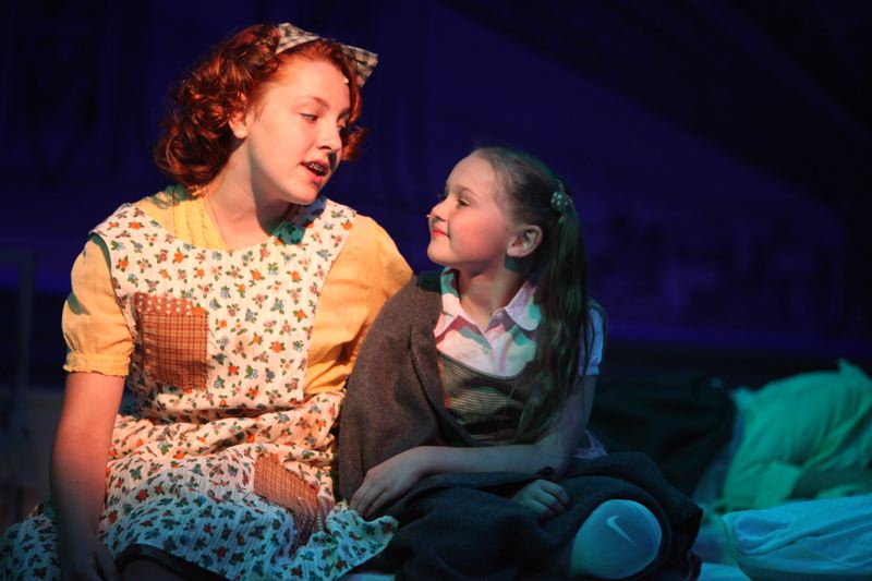 CONTRIBUTED PHOTO: CLACKAMAS REPERTORY THEATER - Ava Marie and Cora Craver as Molly sing the song Maybe in the Clackamas Reps production of Annie.