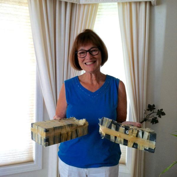 OUTLOOK PHOTOS: TERESA CARSON - Retired Barlow High School English teacher Sue Schneibel holds the time capsules her students created and encased in the walls of the school in 1974.
