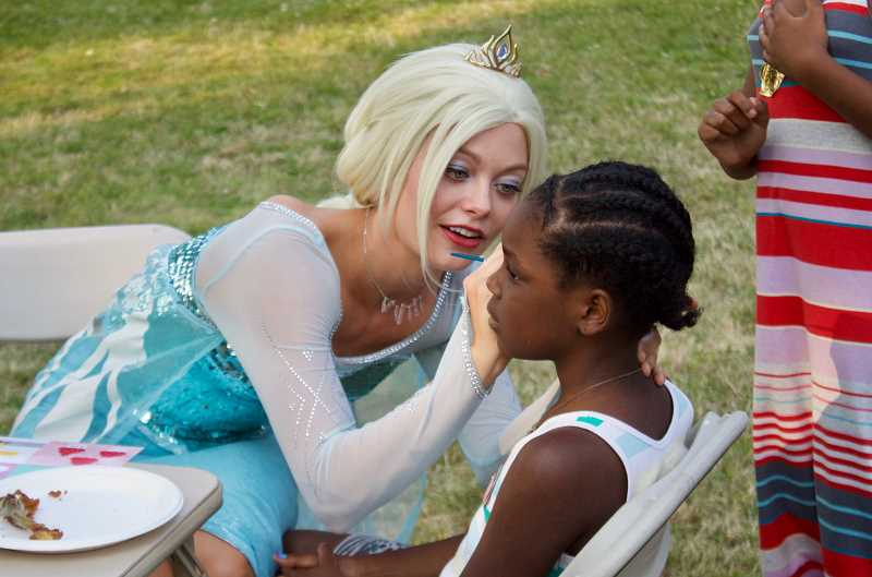 OUTLOOK PHOTO: CHRISTOPHER KEIZUR - Queen Elsa, the popular character from Frozen, painted faces for National Night Out.