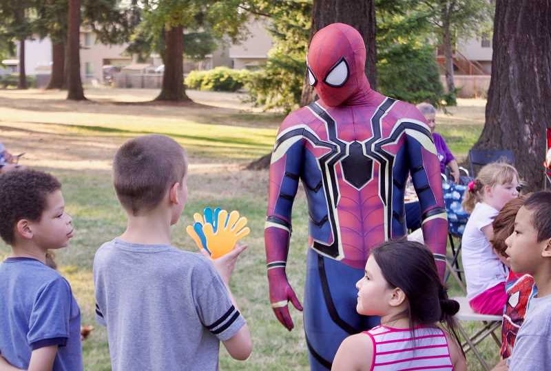 OUTLOOK PHOTO: CHRISTOPHER KEIZUR - Spiderman gathered the kids for a superhero training course during National Night Out Tuesday evening, Aug. 7.