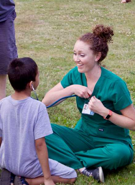OUTLOOK PHOTO: CHRISTOPHER KEIZUR - Oregon Health and Science University nurses shared wellness tips with the children enjoying National Night Out.