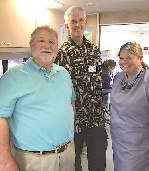 COURTESY PHOTO: TERRY HOTCHKIN - (From left) Kendall Horn, Denny Sanders and Mary Beth Bowman are dentists who donate their time every few months to provide free dental care to needy patients in Woodburn.