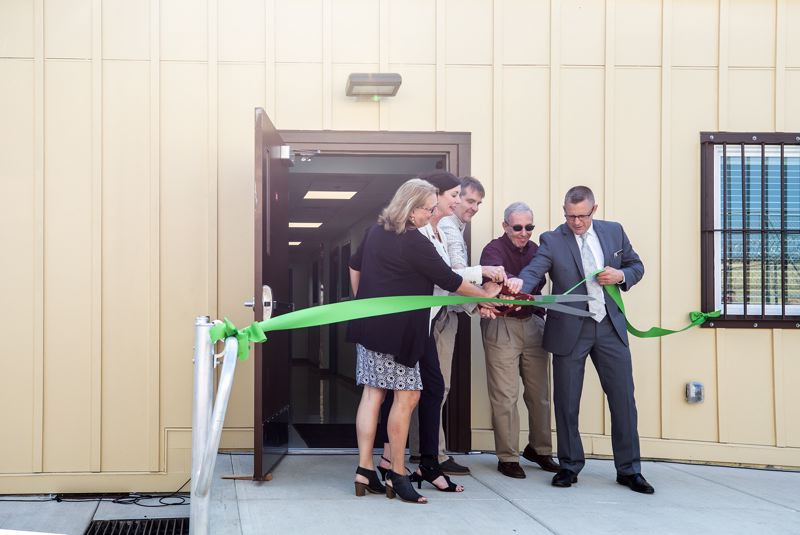 JON HOUSE/PORTLAND TRIBUNE - Left to right, Rep. Denyc Boles, R-Salem, DOC Director Colette Peters, Tom Stenson and Joel Greenberg, both of Disability Rights Oregon, and Brandon Kelly, superintendent of the Oregon State Penitentiary, cut the ribbon for the opening of the penitentiary's new behavioral health treatment center.
