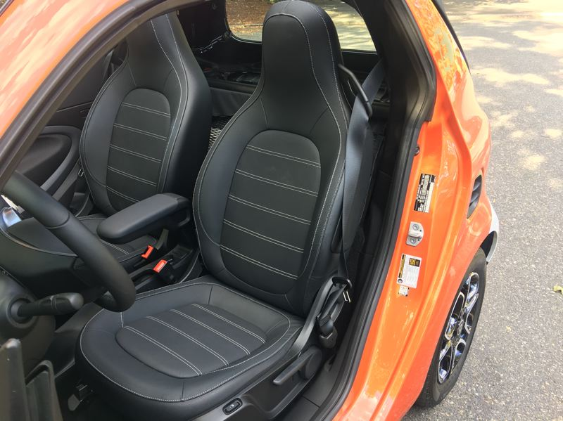 PORTLAND TRIBUNE: JEFF ZURSCHMEIDE - Both passengers will find a surprising amount of room and comfort in the 2018 smart fortwo electric drive cabrio, but there is no back seat or even much carrying room behind them.
