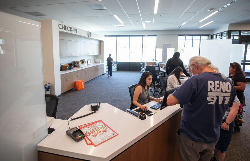TIMES PHOTO: JONATHAN HOUSE - Staff help patients in the lobby of the new Virginia Garcia Clinic in Beaverton.