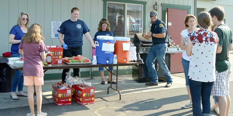 PIONEER PHOTO: CINDY FAMA - The barbecue stand at Colton's National Night Out. Pictured from left to right are: Wendy Oberlander, Julia LIngle, Geri Fraijo and Tyler Norlin.