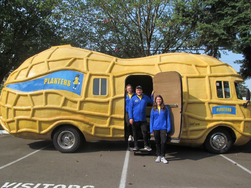 PHOTO BY ELLEN SPITALERI - 'Peanutters' Molly O'Brien, Patrick Golden and Jenna Stoklosa are recent college graduates who have driven the Planters Nutmobile from Wisconsin to Oregon.