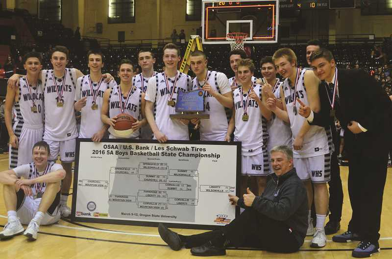 ARCHIVE PHOTO: COREY BUCHANAN - The 2015-2016 Wilsonville boys basketball champions after their win.