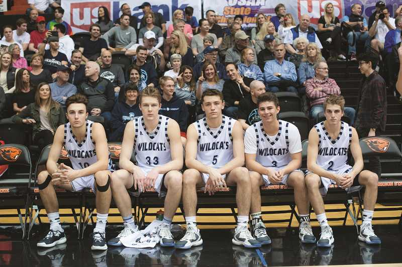ARCHIVE PHOTO: COREY BUCHANAN - The starting five for the 2016-2017 state champions. From left to right: Zac Woodworth, Zach Reichle, Harrison Steiger, Jack Roche Caleb Larsen.