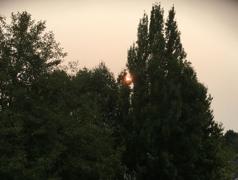 PAMPLIN MEDIA GROUP: KEVIN HARDEN - A haze from wildfire smoke produced a deep red sunrise for most Portland-area residents Tuesday morning. The region's air quality is considered unhealthy for some people.