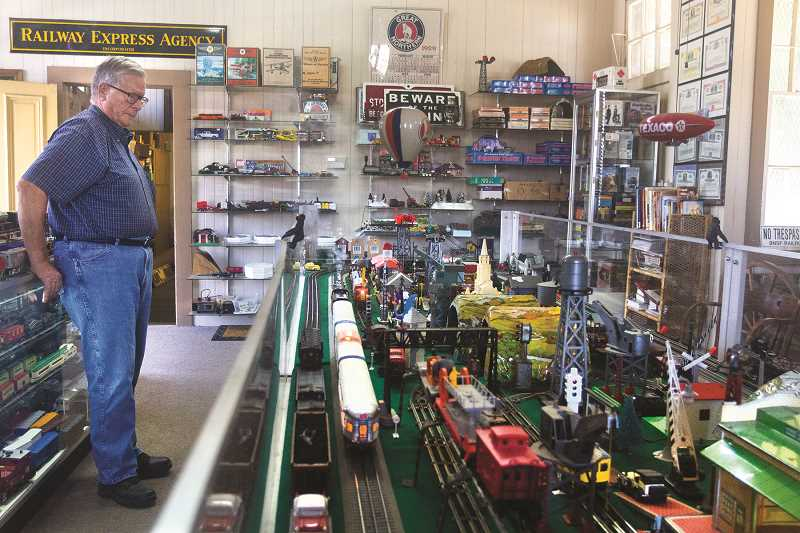 PATRICK EVANS - Al Ketchum watches over his tracks as a model passenger train steams down the line.