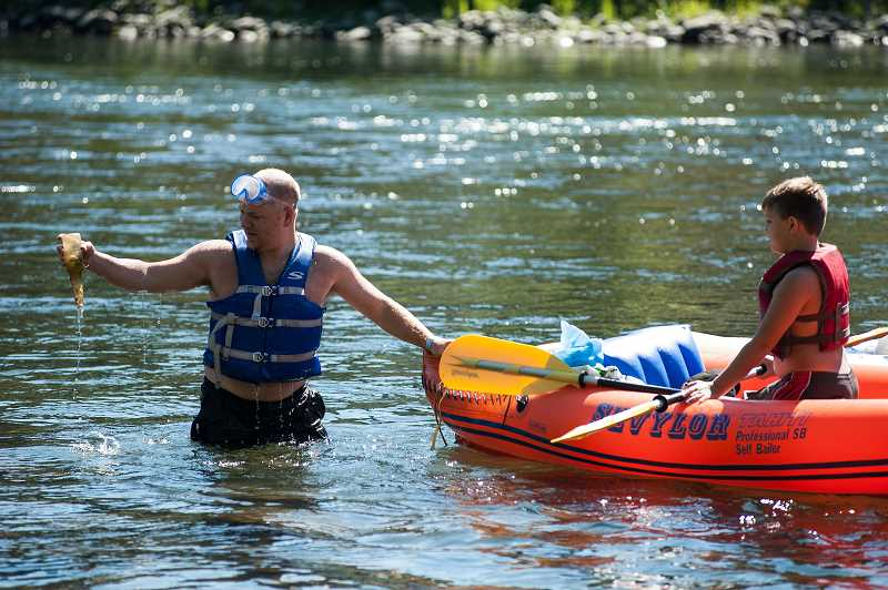 CONTRIBUTED PHOTO: MARK GAMBA - Participants in the annual Down the River Cleanup on the Clackamas River pick up trash on boats. This year's event is scheduled for Sunday, Sept. 9.