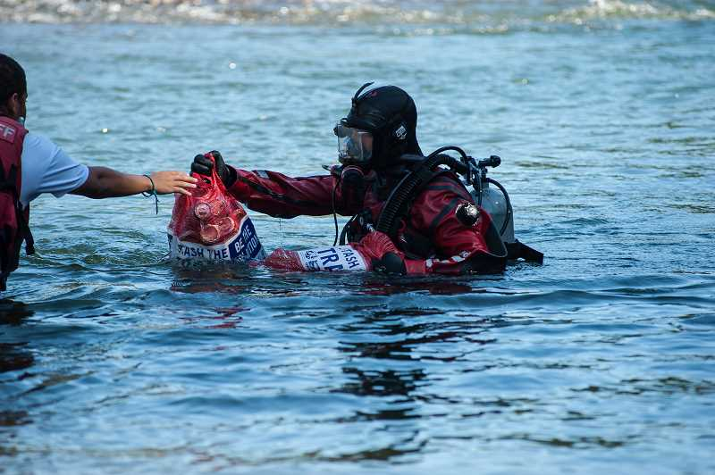 CONTRIBUTED PHOTO: MARK GAMBA - Divers remove garbage from the Clackamas River during the Down the River Cleanup.