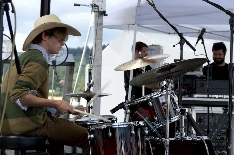 SPOKESMAN PHOTO: CLARA HOWELL  - Zac Cross plays the drums in the YMP Intern Band.