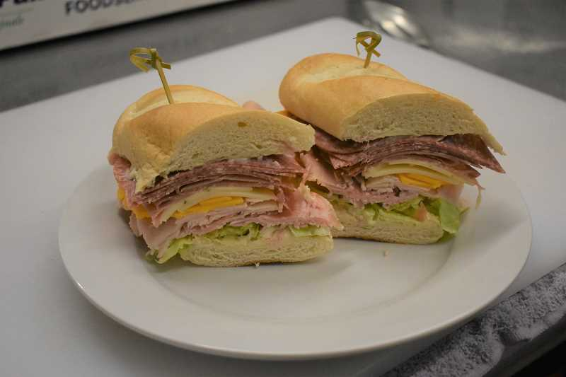 ESTACADA NEWS PHOTO: EMILY LINDSTRAND - The Matty bomb at The Cazadero includes 2 ounces of ham, 2 ounces of turkey, 2 ounces of prosciutto, eight slices of salami, pepper jack cheese, swiss cheese, lettuce and tomatoes.