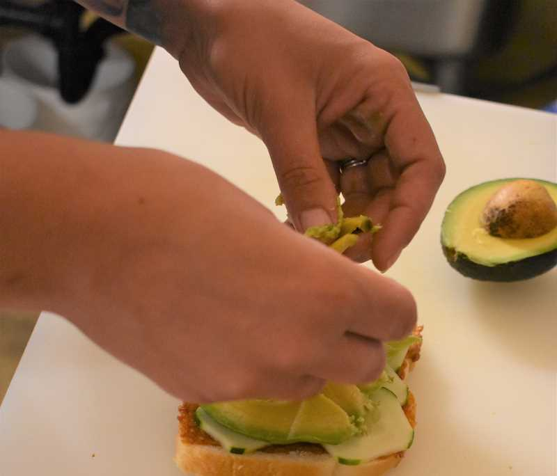 ESTACADA NEWS PHOTO: EMILY LINDSTRAND - Avacado is one of the many vegetables on the Mason Jar's cucumber sandwich.