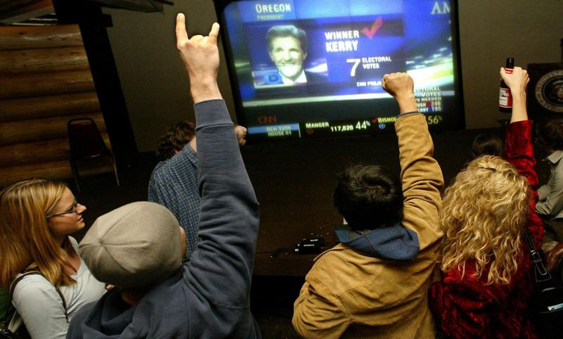 PAMPLIN MEDIA GROUP FILE PHOTO - Supporters of Sen. John Kerry watch results on CNN during the 2004 presidential election. Fourteen years later, the cable news giant has become a favorite target of President Donald Trump, who frequently castigates it and other news outlets that report on his administration as 'fake news.'