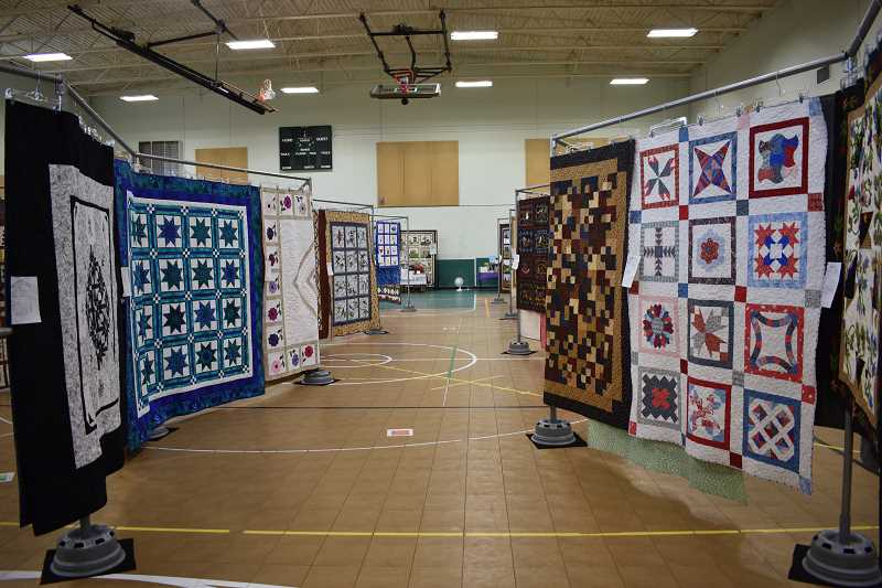 ESTACADA NEWS PHOTO: EMILY LINDSTRAND - There were a variety of quilts on display at the Skip-a-Week Club's show last month.
