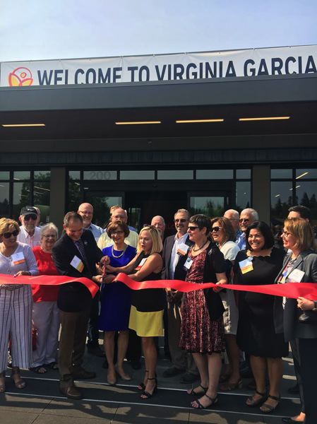 PHOTO COURTESY U.S. REP. SUZANNE BONAMICI - U.S. Rep. Suzanne Bonamici, in blue, takes part in the ceremonial ribbon-cutting for the new Beaverton Wellness Center of Virginia Garcia Memorial Health Center