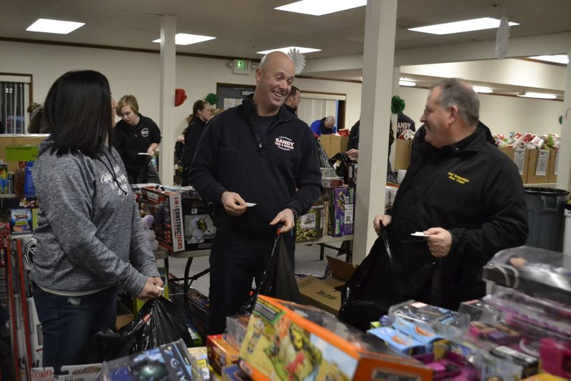 FILE PHOTO - The Sandy Kiwanis bring together people fom all different local groups to help fill Christmas baskets for families in December.