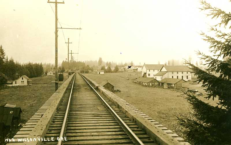 PHOTO COURTESY WILSONVILLE-BOONES FERRY HISTORICAL SOCIETY - A view looking north to Wilsonville from the Willamette River railway trestle in 1910. One of the two-story buildings on the right still stands at the corner of 5th Street and Boones Ferry. Now a residence, it was previously a dance hall, feed store, rolling skating rink and a movie house.