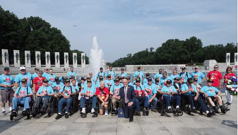 PHOTO BY CLINT MCAULIFFE - The C.O. Korean War Veterans pose with Rep. Greg Walden in front of the World War II Memorial.