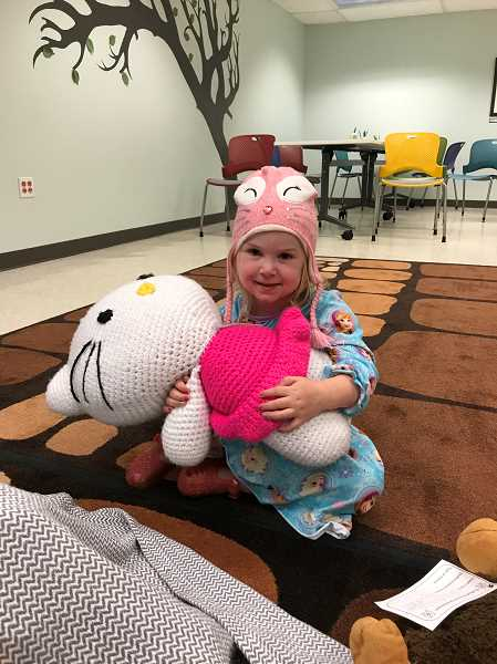 SUBMITTED PHOTO: SARAH FLATHMAN - Summer Clark gets ready to leave Hello Kitty at the animal sleepover.