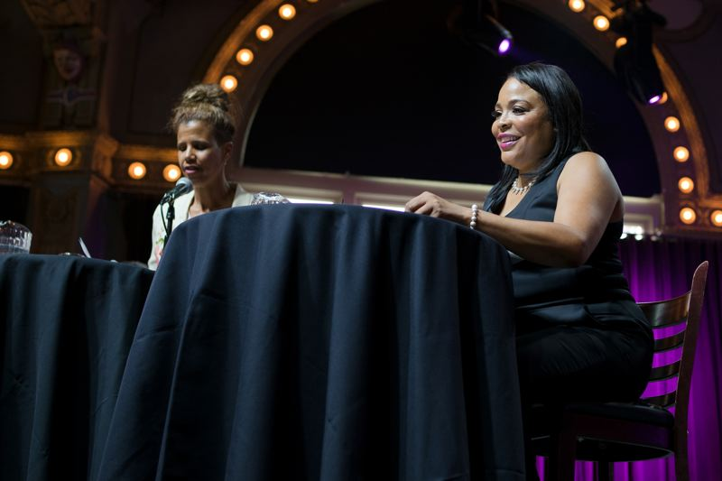 TRIBUNE PHOTO: KIT MACAVOY - Loretta Smith, right, smiles as she is introduced in the Race Talks forum at the Crystal Ballroom Tuesday night. On the left is moderator Tricia Tillman.