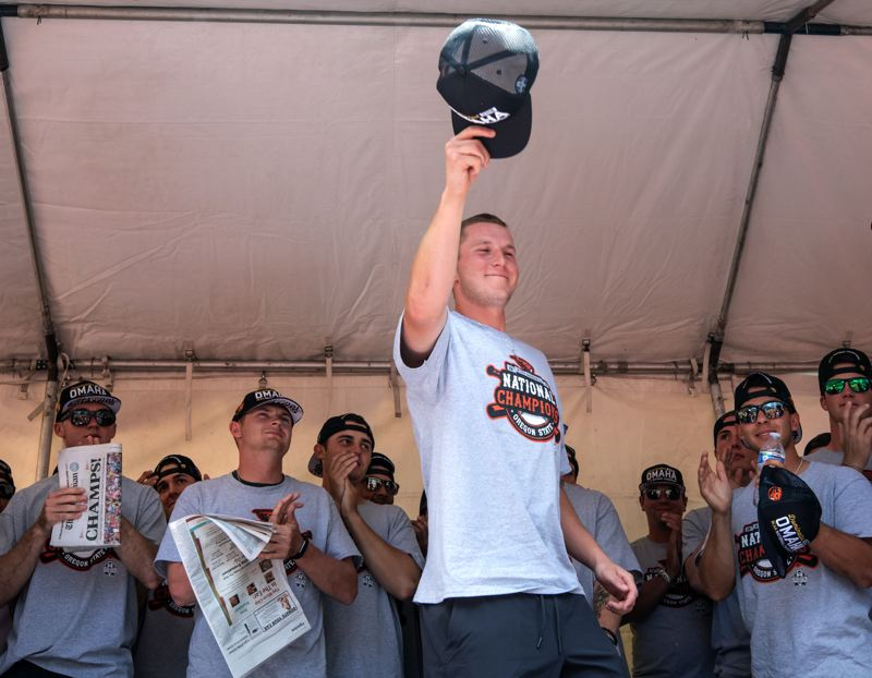 TIMES PHOTO: JONATHAN HOUSE - Zak Taylor, a 2015 Sherwood High School graduate, tips his cap to the crowd at Portlands Pioneer Courthouse Square during the OSU Beavers national championship celebration.