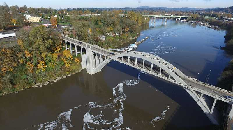 TIDINGS FILE PHOTO - Residents fear that tolling on the Abernethy Bridge (pictured in background) would cause traffic diversion onto the Arch Bridge and other local roads.