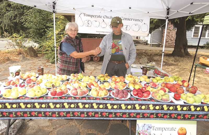COURTESY PHOTO: DAVE JACKSON - Joanie Cooper and Shaun Shepherd of Temperate Orchard Conservancy at the 2017 Apple Fest.