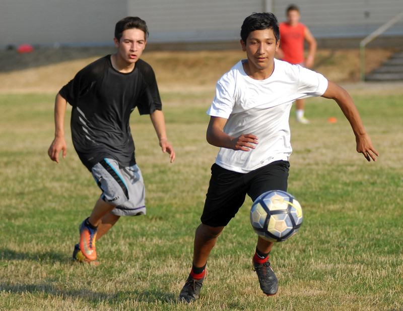 ESTACADA NEWS: MATT RAWLINGS - Raymond Garcia chases down a loose ball during a scrimmage on the first day of boys soccer practice. Estacada  opens the season at 6:30 p.m. Tuesday, Aug. 28, at Banks.