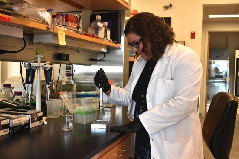 TRIBUNE PHOTO: HAILEY STEWART  - Allison Schaser, a postdoctoral researcher at Oregon Health & Science University, spends much of her research time in a lab.  Shes also president of Women in Science Portland, which aims to teach youth that science is an equal opportunity field.
